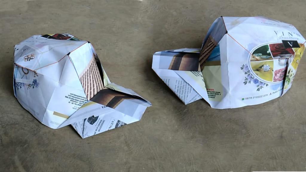 ハディさんによる新聞紙でつくるキャップ帽の折り紙